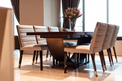 Timeless Malerba dining table with signature bronze arc support base