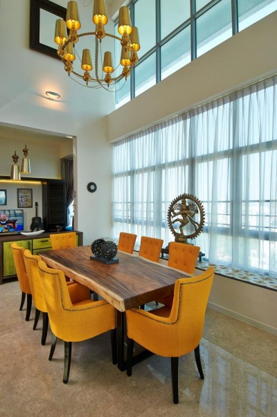 Asian Cosmopolitan Penthouse - Vibrant mustard colour themed Dining with rustic Vietnam coloured tile on bay window