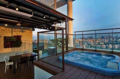 Asian Cosmopolitan Penthouse - Jacuzzi on lifted platform with green wall in the background