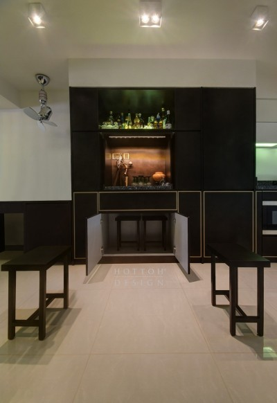 Pantry-cum-mini bar and dining stools concealed within the cabinets