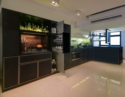 Bespoke pantry cabinets with storage that also conceals a set of built-in fridge and freezer