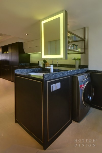 A specially designed aesthetic and functional vanity area with mirror between the kitchen and laundry area