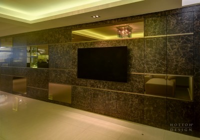 Wall-mounted TV on a full stretch of feature wall with display unit